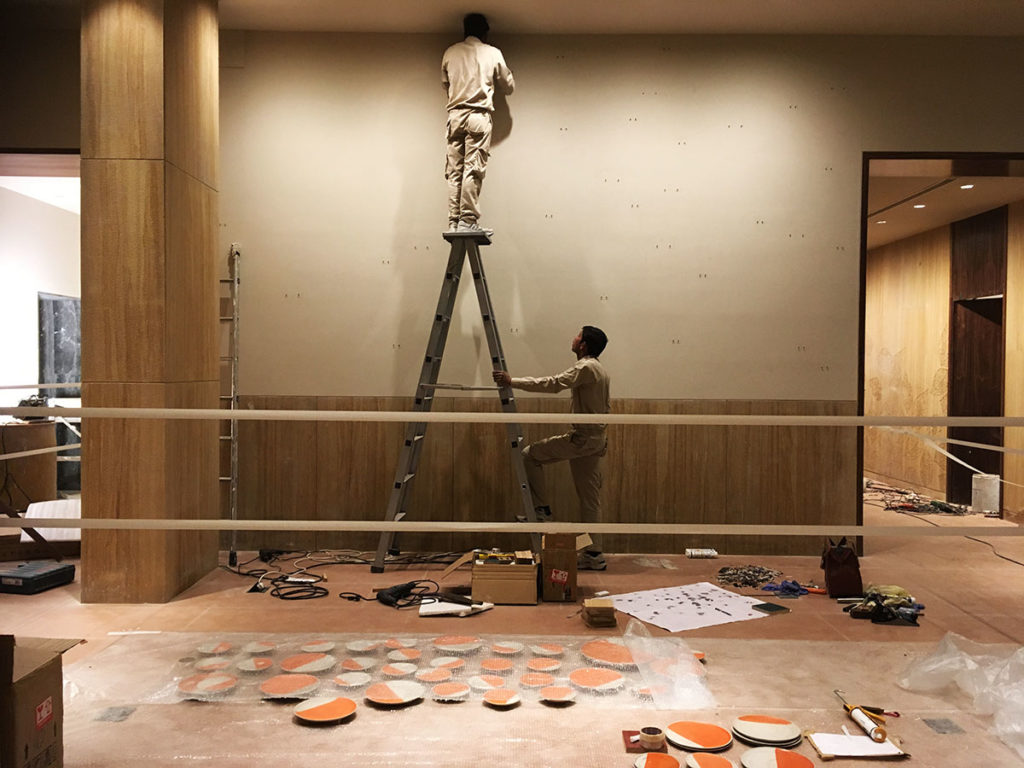 "The team of technicians during the installation of ceramic mural - ""Solar"" by Rekha Goyal"